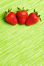 Three red strawberries Royalty Free Stock Image