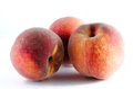 Three ripe peaches isolated on white background Royalty Free Stock Photo