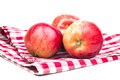 Three ripe red apples on a towel Royalty Free Stock Photo