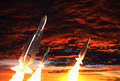 Three Rockets Takes Off On The Background Of Apocalyptic Sky