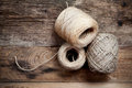 Three rope coils on old wooden background Royalty Free Stock Photo