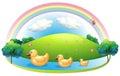 Three rubber ducks near the hill Royalty Free Stock Photo