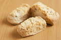 Three rusks on a wooden surface Royalty Free Stock Photos
