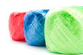 Three s company arrangement of plastic twine in blue green and red on white background Royalty Free Stock Photos