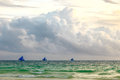 Three sailing boats on horizon of sauset tropical blue sea, Phil Royalty Free Stock Photo