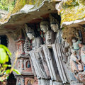 Three saints of huayan school of buddhism the niche at dazu chongqing china Stock Photo