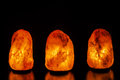Three salt lamps on black background Royalty Free Stock Photo