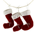 Three santa boots isolated red on string on white Royalty Free Stock Image