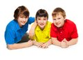 Three schoolboys laying together floor smiling looks happy exited isolated whtie Stock Photography
