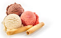 Three scoops of ice cream with wafer rolls Royalty Free Stock Photo