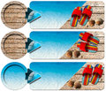 Three sea holiday banners n with blue water wooden floor with sand colored sandals seashells and blue arrow Royalty Free Stock Images