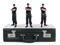 Three security guys standing black cipher suitcase shot white security concept Royalty Free Stock Photography