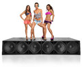 Three seductive girls standing on speakers young Stock Photo