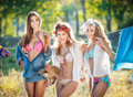 Three sexy women with provocative outfits putting clothes to dry in sun sensual young females laughing putting out the washing Royalty Free Stock Photo