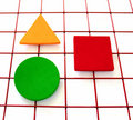 Three shapes on a grid Stock Photography