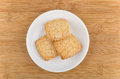 Three shortbread cookies in white saucer Royalty Free Stock Photo