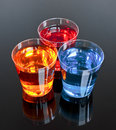 Three shots on a black background perfect for promotions or offer in the alcoholic drinks industry Royalty Free Stock Images