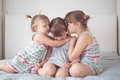 Three sibling sisters  in real interior, lifestyle Royalty Free Stock Photo