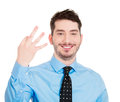 Three sign man closeup portrait of young handsome giving a fingers gesture with hands isolated on white background positive human Stock Image