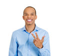 Three sign smiling man closeup portrait of young handsome business giving fingers gesture with hands isolated on white background Stock Image