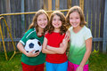 Three sister girls friends soccer football winner players on the backyard Stock Images