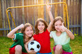 Three sister girls friends soccer football winner players on the backyard Stock Photo