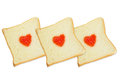 Three slice breads with fruit jam heart shape on white background Royalty Free Stock Photo