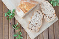 Three slices of bread and green leaves on  table Royalty Free Stock Photo