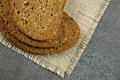 Three slices of grain bread on burlap coth. Royalty Free Stock Photo