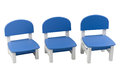 Three of small blue chairs for child Stock Photo