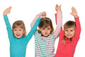 Three small girls standing together white background Stock Photography
