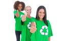 Three smiling enviromental activists giving thumbs up in a line on white background Stock Photography