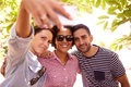 Three smiling friends taking a selfie Royalty Free Stock Photo