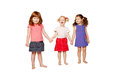 Three smiling little girls holding hands Stock Photos