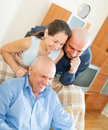 Three smiling people mid adults friends at home Stock Image