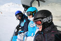 Three smiling skiers ride on funicular Royalty Free Stock Photography