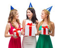 Three smiling women in blue hats with gift boxes celebration friends bachelorette party birthday concept wearing Royalty Free Stock Images