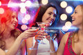 Three smiling women with cocktails and disco ball new year celebration friends bachelorette party birthday concept in evening Stock Photography