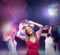 Three smiling women dancing in the club party celebration friends bachelorette party birthday concept beautiful evening dresses Stock Image