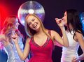 Three smiling women dancing in the club party new year celebration friends bachelorette party birthday concept beautiful evening Stock Image