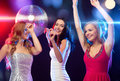 Three smiling women dancing in the club party new year celebration friends bachelorette party birthday concept beautiful evening Royalty Free Stock Images