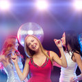 Three smiling women dancing in the club party new year celebration friends bachelorette party birthday concept beautiful evening Stock Photography