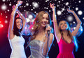 Three smiling women dancing and singing karaoke party new year celebration friends bachelorette party birthday concept in evening Stock Photos