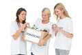 Three smiling young women with donation box Royalty Free Stock Photo