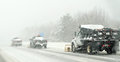 Three snow plow trucks clearing highway road snow storm Royalty Free Stock Photography