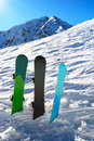 Three snowboards under sun Stock Photo