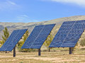 Three solar panels used in a desert rural area Stock Image