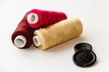 Three spools thread buttons light background Stock Photography
