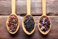 Three spoons with dried assorted tea leaves Royalty Free Stock Photo