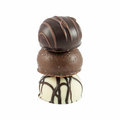 Three stacked gourmet chocolate bonbons on white background Royalty Free Stock Photo